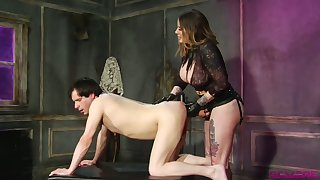Sex-crazy mistress Madeline Marlowe fucks dude's anus with strapon with an increment of fist